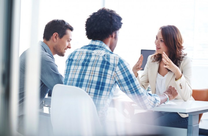 Shot of three young colleagues having a meeting in the boardroom