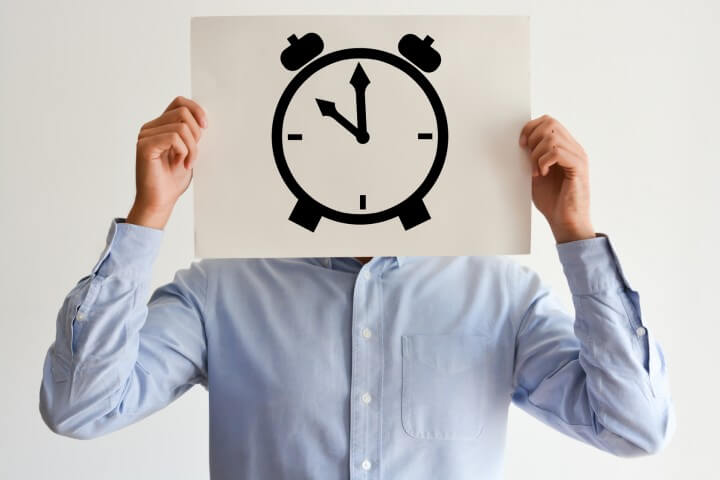 Now or deadline concept with stressed employee or businessman