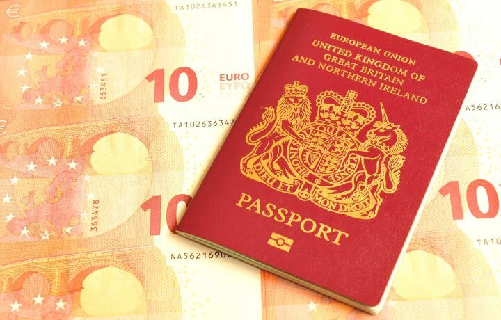 UK in euro zone concept with British passport and euro banknotes