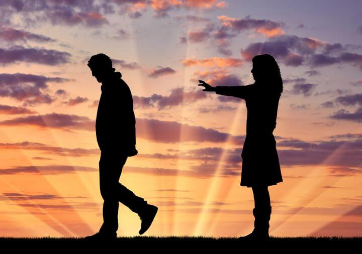 Concept of deceit and betrayal. Silhouette man leaves from the woman to his mistress at sunset