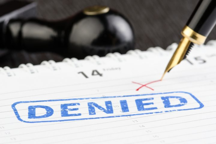 Close up shot of denied stamp on a planner