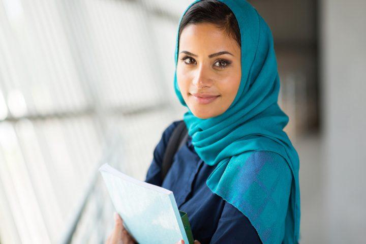 portrait of pretty muslim college student