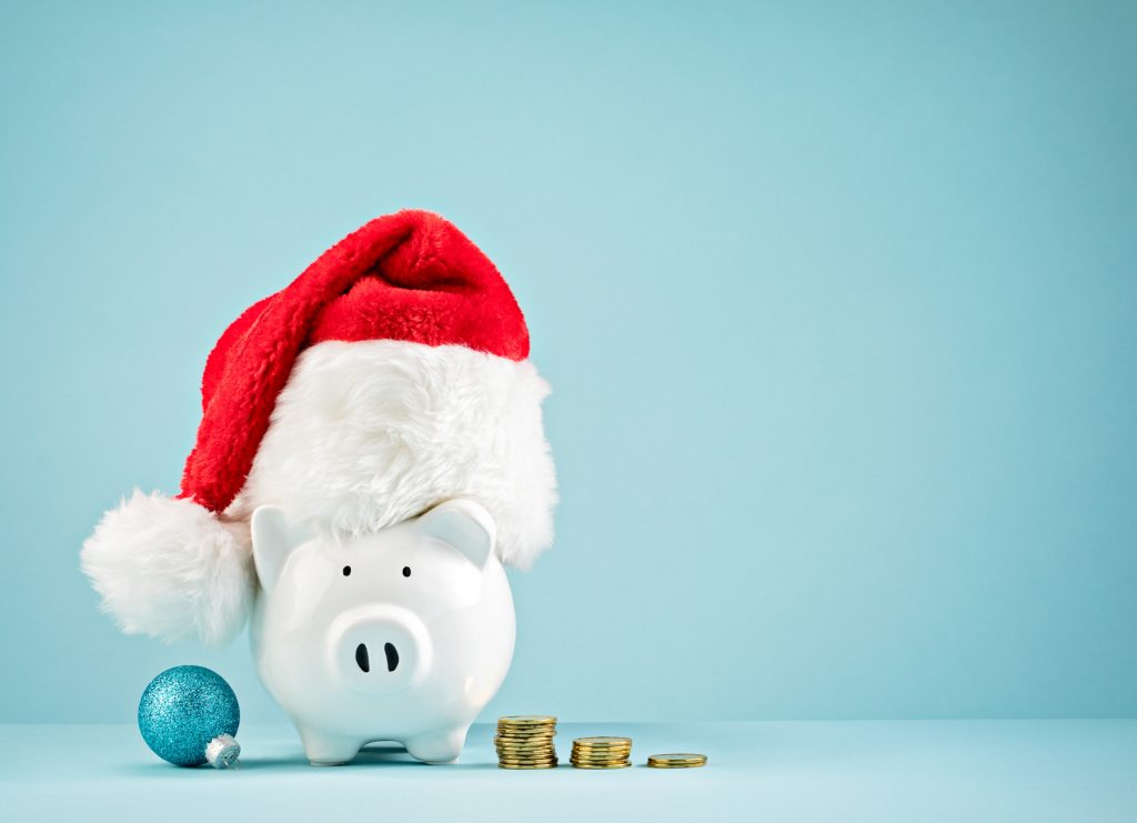 Piggy bank wearing santa hat